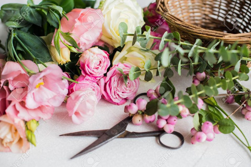 45683333-fresh-flowers-leaves-and-tools-to-create-a-bouquet-on-a-table-florist-s-workplace-