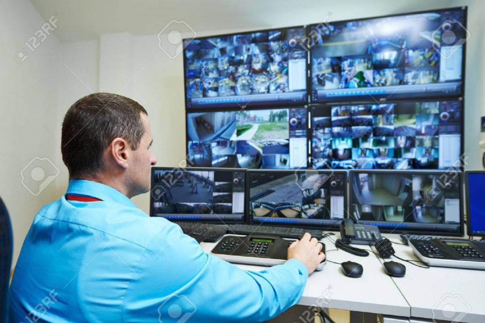 31112212-security-guard-watching-video-monitoring-surveillance-security-system