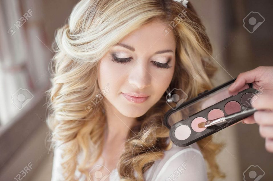 46144411-beautiful-bride-wedding-with-makeup-and-curly-hairstyle-stylist-makes-make-up-bride-on-wedding-day-b